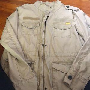 Tan thin layer utility jacket